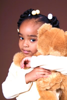 image of little girl with teddy-bear